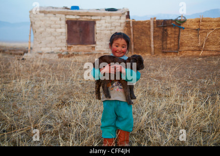 Young Mongolian nomad boy with his goat, Province of Khovd, Mongolia, Central Asia, Asia - Stock Photo