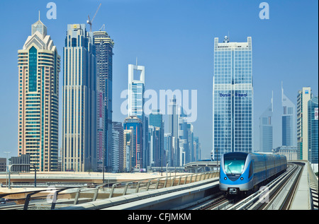 Sheikh Zayed Road skyline of high rise buildings and skyscrapers, and metro train, Dubai City, United Arab Emirates, - Stock Photo