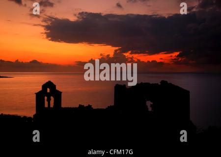 Sunset at the abandoned monastery of Panagia Vretti, Limeni village, Mani, Lakonia, Peloponnese, Greece - Stock Photo