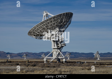 VLA, Very Large Array, NM, NRAO, National Radio Astronomy Observatory, daylight, one large against smaller radio - Stock Photo