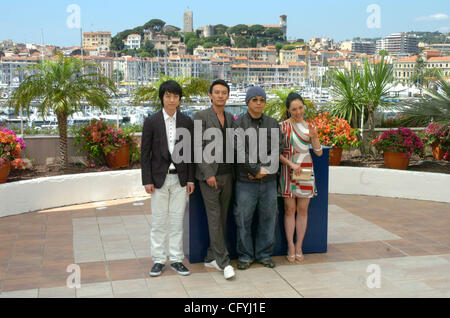 Actors CHANG Chen, KANG InHuyng, actress ZIA and director KIM Ki-duk at the 2007 Cannes festival for 'Soom' photocall. - Stock Photo