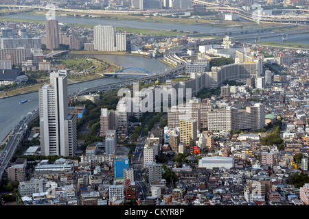 September 5, 2012, Tokyo, Japan - A cluster of decrepit houses stand side by side along narrow allies barely wide - Stock Photo