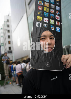 Japan, Tokyo. 21st September 2012. Japanese Apple fan waits in line for his new iphone 5 on the day of the release. - Stock Photo