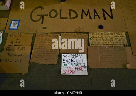 October 24, 2012, New York, NY, US.  Close-up of Occupy Goldman Sachs signs on sidewalk, denouncing the bank's Chief - Stock Photo