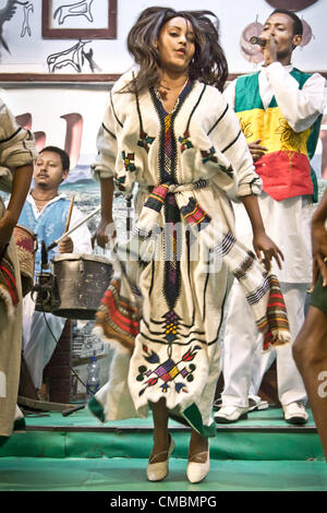 ADDIS ABABA, ETHIOPIA – JULY 11: Dancers and musicians perform the traditional dances of different ethnic groups - Stock Photo