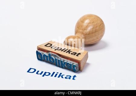 Detailansicht eines Stempels mit der Aufschrift Duplikat | Detail photo of a stamp with inscription in German copy - Stock Photo