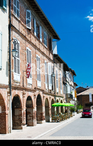 Cafe on Market Square in Lisle Sur Tarn, France - Stock Photo