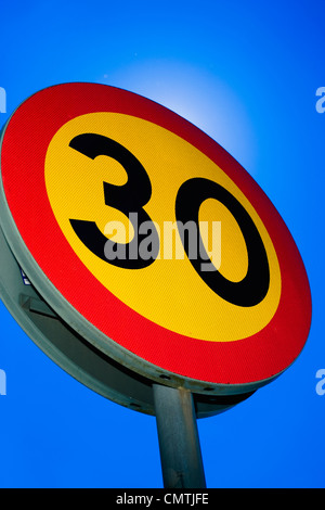 Speed limit sign against blue sky - Stock Photo