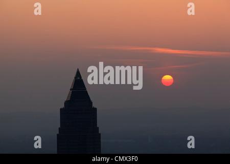 Germany, Frankfurt, View of Messeturm at sunset - Stock Photo