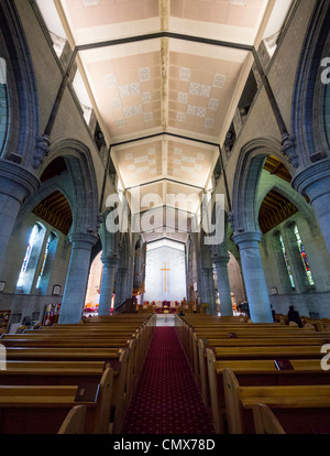 Interior of Christ Church Cathedral, New Zealand - view down the nave looking Wast towards the sanctuary - Stock Photo
