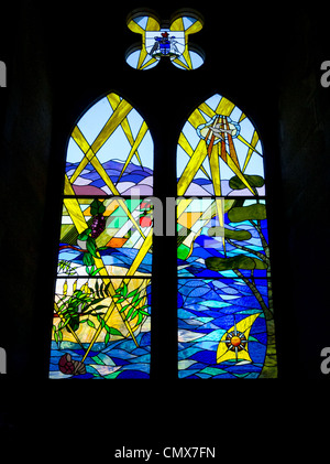 Interior of Christ Church Cathedral, New Zealand - stained glass window depicting New Zealand landscape. - Stock Photo