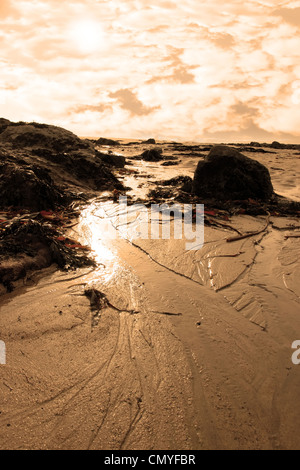 rocks on beale beach co kerry ireland on a red sunset day - Stock Photo