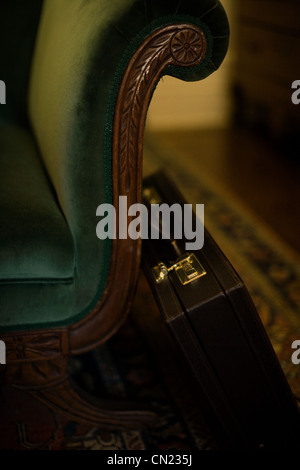 Armchair and briefcase - Stock Photo