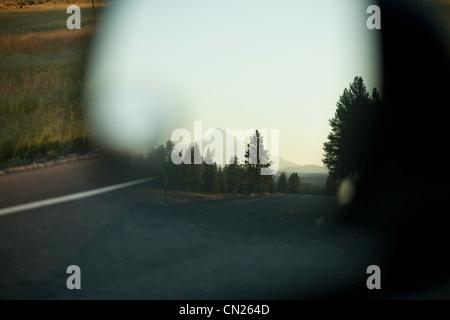 Mount Hood seen in car mirror, Portland, Oregon - Stock Photo