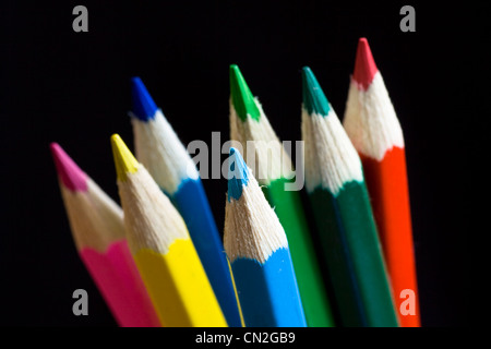 Color pencils on black background. Selective focus. - Stock Photo