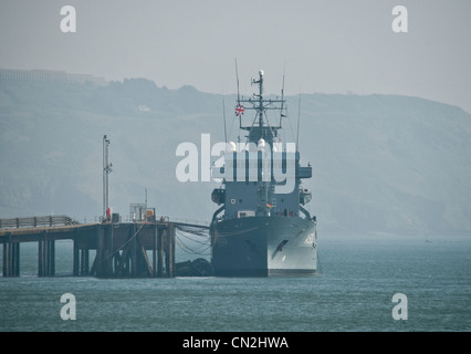 A Royal Fleet Auxiliary ship being loaded up in Devonport Docks - Stock Photo