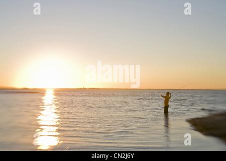 Man Fly Fishing at Sunrise, Florida Keys, USA - Stock Photo