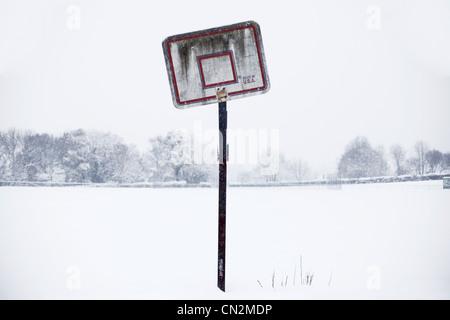 Basketball hoop in snow - Stock Photo