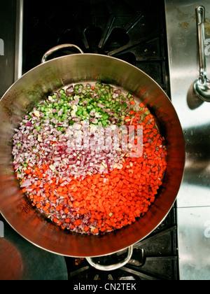 Saucepan of freshly chopped vegetables - Stock Photo