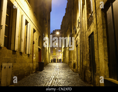 Cobbled street at night, Bordeaux, France - Stock Photo