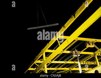 Yellow steel girder framework on construction site - Stock Photo