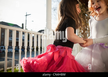 Girls dancing in ballet costumes on porch - Stock Photo