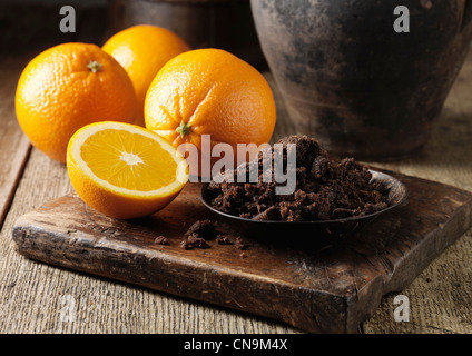 Muscovado sugar and oranges on board - Stock Photo