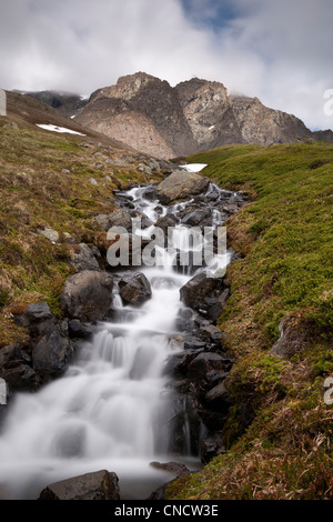 A stream decends from Mount Rumble, Chugach State Park, Southcentral Alaska, Summer - Stock Photo