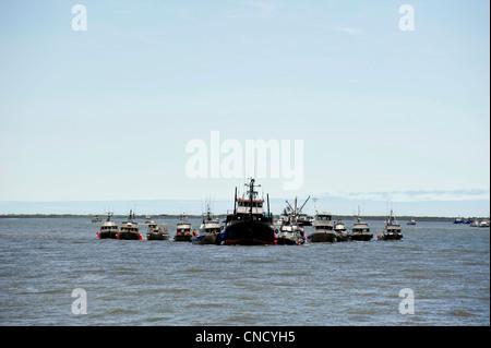 Drift net boats line up at a tender to deliver sockeye salmon in Ugashik Bay in Bristol Bay, Alaska - Stock Photo