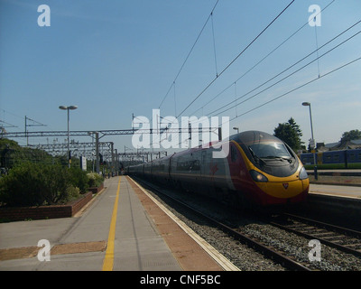 Virgin Trains Class 390 Pendolino No. 390001 'Virgin Pioneer' arriving at Watford Junction. - Stock Photo
