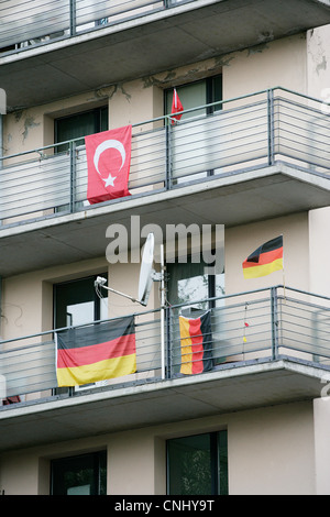 Turkish and German flags on balconies, Kreuzberg, Berlin, Germany - Stock Photo