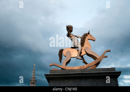 Sculpture of Child on rocking horse on the fourth plinth in Trafalgar Square, London, UK - Stock Photo