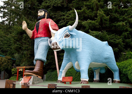 Paul Bunyan and Babe the Blue Ox statues at Trees of Mystery, a roadside attraction located in Klamath, California, - Stock Photo