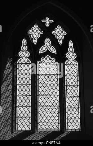 Window in St. Giles Church, Imber, Salisbury Plain, Wiltshire, UK.  Accessible only a few days a year. - Stock Photo