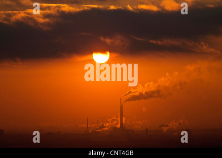 industrial landscape in sunset, Germany, North Rhine-Westphalia, Ruhr Area, Oberhausen - Stock Photo