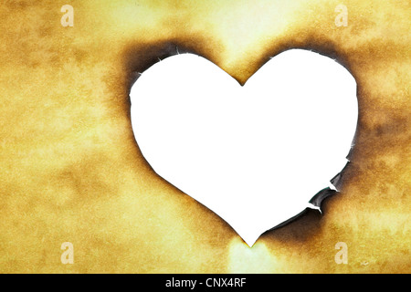 Hole looking as heart symbol close up - Stock Photo