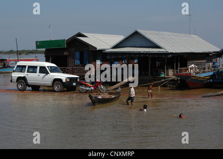 Floating village in Tonle Sap Lake near Siam Reap, Cambodia. - Stock Photo