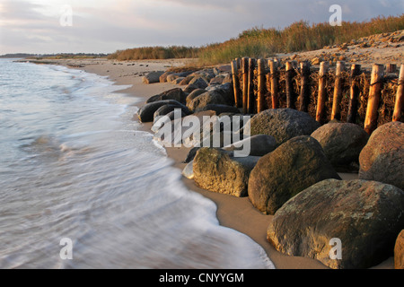 ocean surf at the sand beach in front of coastal fortification, Germany, Schleswig-Holstein, Munkmarsch, Sylt - Stock Photo