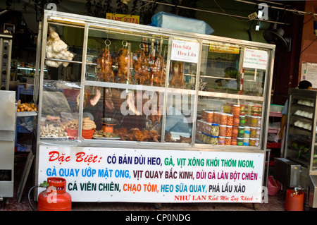 Horizontal close up of a fastfood stand selling traditional hot Vietnamese food. - Stock Photo