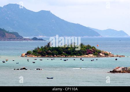 Fishing boats in the bay in Nha Trang, Vietnam. - Stock Photo