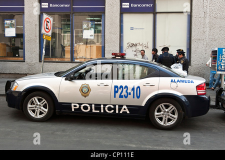 street scene with late model police cruiser car & policemen on routine duty in Centro Historico district Mexico - Stock Photo