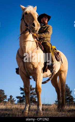 Cowboy on horseback in northeastern Wyoming - Stock Photo