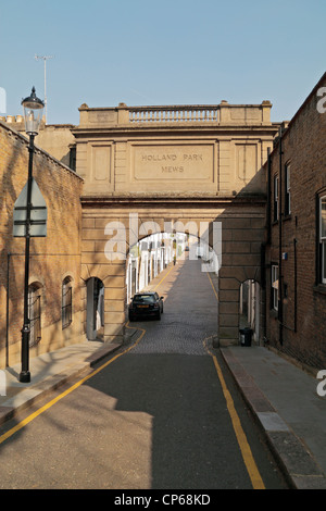View towards entrance archway to Holland Park Mews W11, London, UK.  Former servant quarters that are now highly - Stock Photo