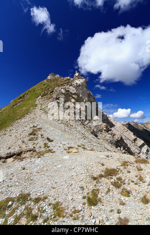 white clouds over mountain summit in Italian Dolomites - Stock Photo