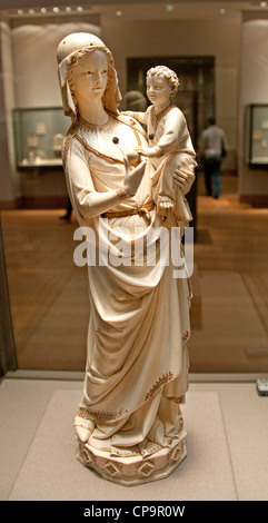 Virgin and Child statuette 12 Century Paris Comes from the Ivory Treasure of Sainte Chapelle in Paris France - Stock Photo