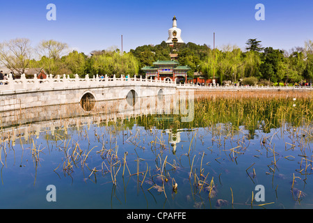 Beihai Park and the White Pagoda, Beijing, on a bright spring day. - Stock Photo