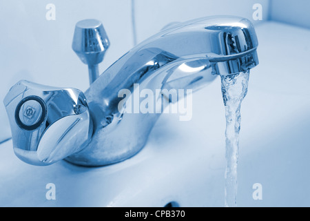 Running water from a faucet - Stock Photo