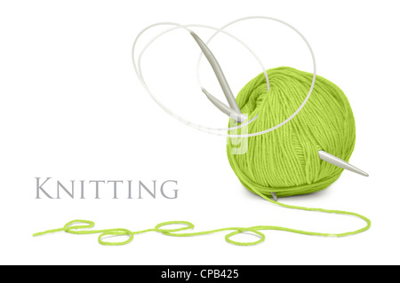ball of green wool and knitting needles isolated on a white background - Stock Photo