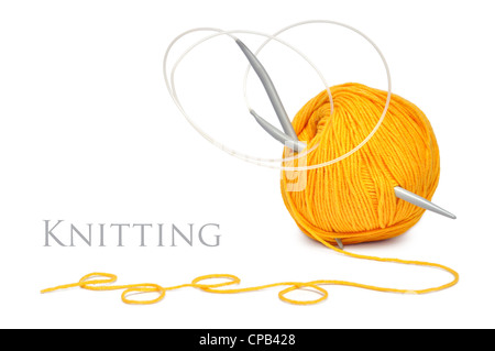 ball of yellow wool and knitting needles isolated on a white background - Stock Photo