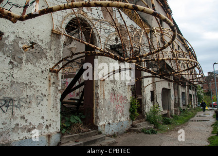 Ruined buildings with bullet holes, Mostar, Bosnia and Herzegovina - Stock Photo